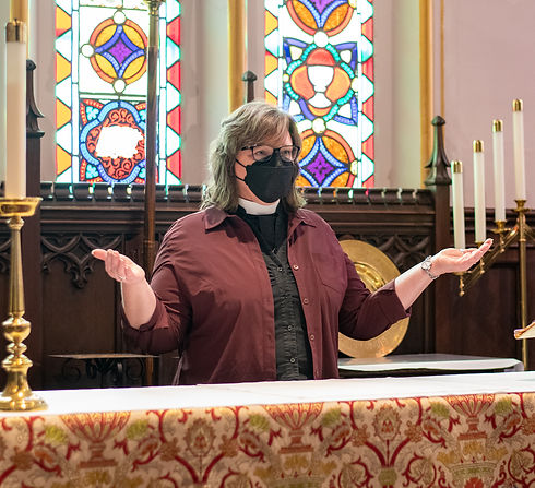 The Rev'd Canon Katherine Morgan at St. John's Church, Thorold behind the altar.