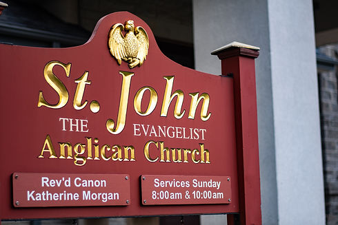 St. John's Church, sign shows the formal name St. John the Evangelist Anglican Church as well as service times.