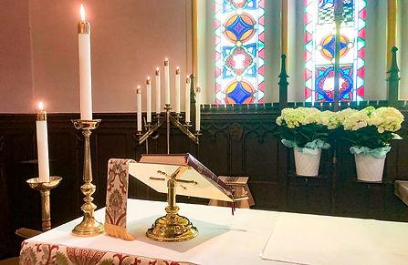 Missal, Candelabra, and Hydrangeas behind the altar.