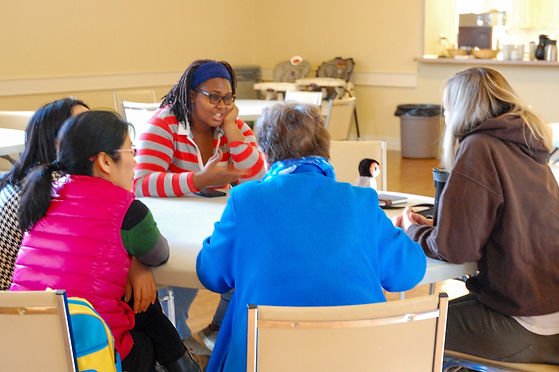 Adults share a on faith and more on Family Day at St. John's Church, Thorold.