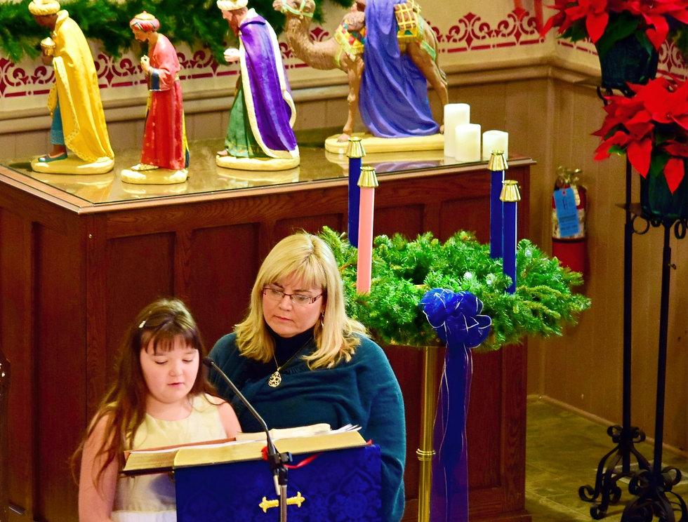 A girl (with her mom looking on) read the weekly scripture reading for the Advent Sunday service at St. John's Church, Thorold.