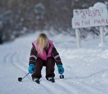 little girl squatting on skis.jpg