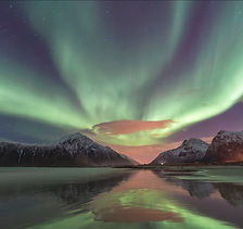 Northern lights over the beach in Lofoten, Norway.  Aurora Borealis reflected in the wet sand on the beach.
