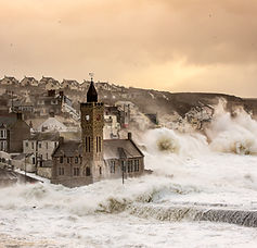 Porthleven storms during 2014, massive waves pounding the shores of Porthleven in Cornwall, A storm never forgotten.