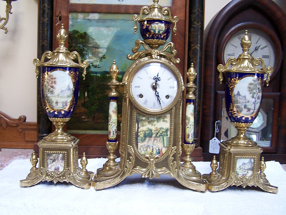 IMPERIAL CLOCK & MATCHED PAIR OF SIDE GARNITURES