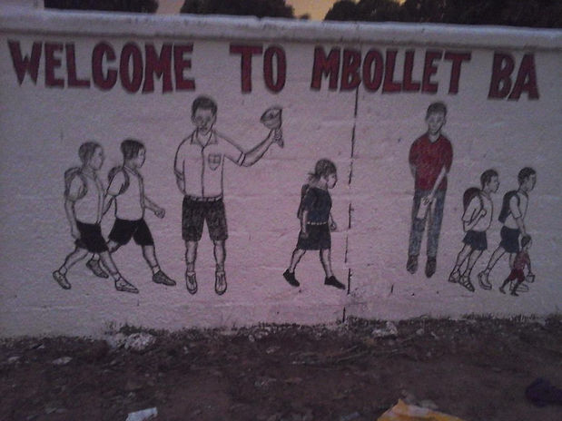 Welcome to Mbollet-ba mural.jpeg