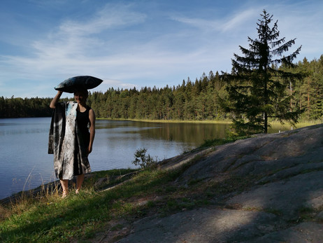 Carrying 'Cliff' pillow by the lake.