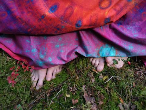 Legs under colorful 'Joiku' bedding