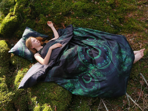 A girl sleeping with 'Forest' bedding