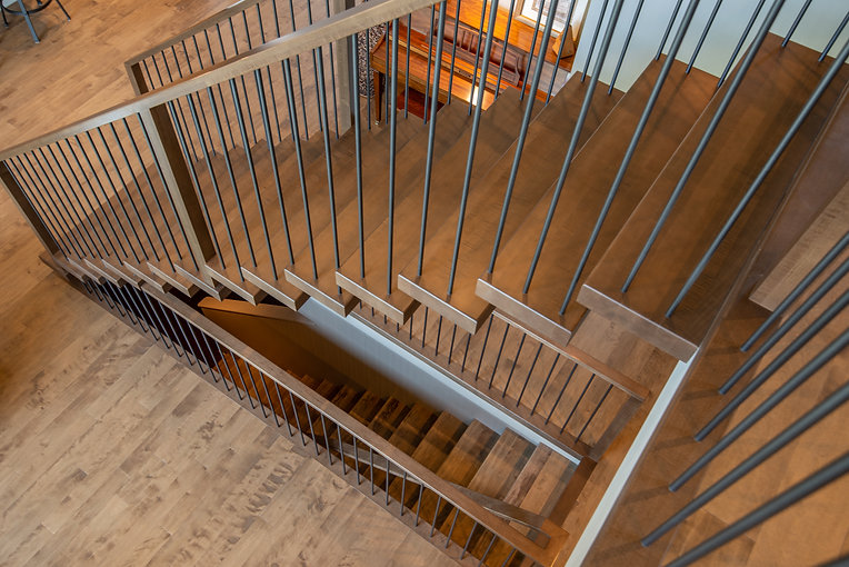 Steel Mono Stringer Staircase with Maple Treads and Steel Spindles