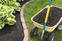Mulchng flowerbeds, black mulch, berks county, Pennsylvania.