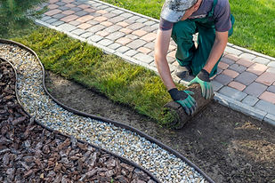 Landscape Gardener Laying Turf For New L