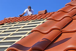 Roofing work, new covering of a tiled ro