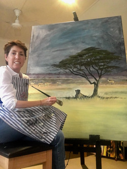 Andy painting leopard and tree
