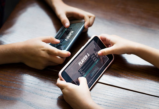 little-boy-playing-mobile-game-against-h