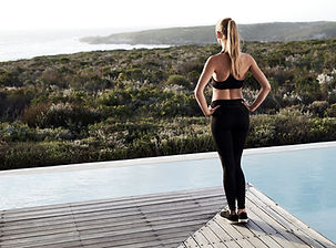 Athletic Girl Looking Over the Landscape