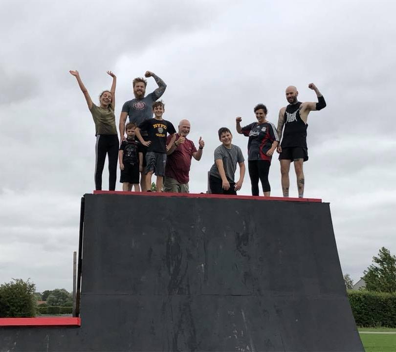 OTG adults on top of half pipe.jpg