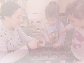 Early Learning Educator and kids playing.