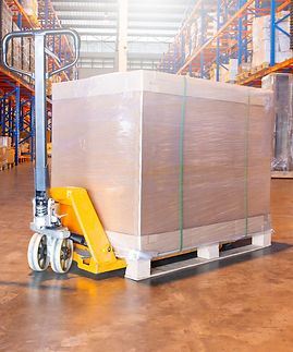 Manual forklift with shipment pallet in