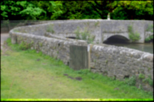 Background image of the bridge at Ashford in the Water.
