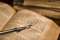 Old hebrew bible book with pointer
