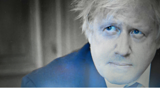 Boris Johnson looks upwards in a whistful manner. He looks serious despite being an utter cretin