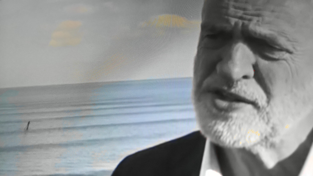 Labour leader Jeremy Corbyn giving an interview with the sea behind him
