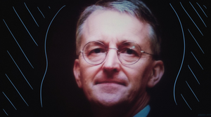 A picture of Hilary Benn MP with some cool blue wavy lines round his face
