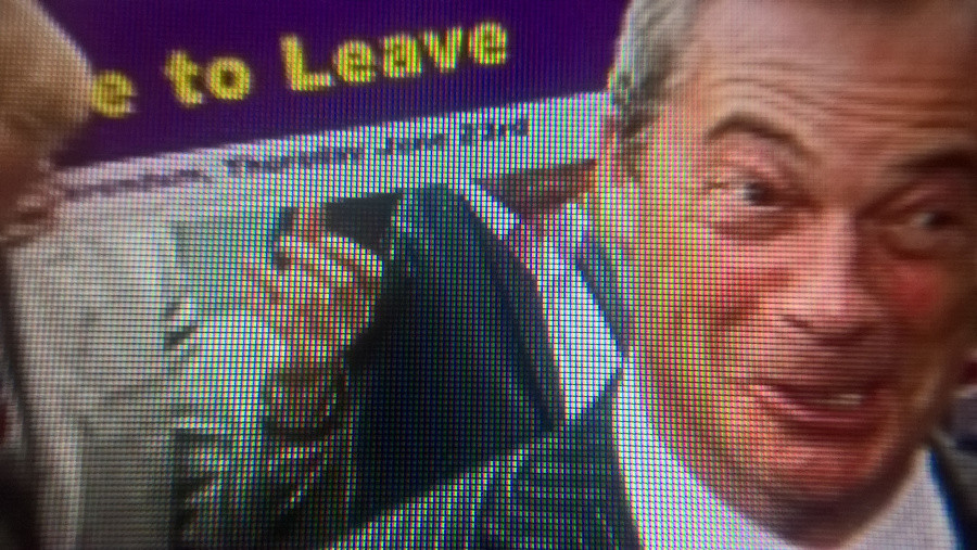 Nigel Farage looking red-faced and smug