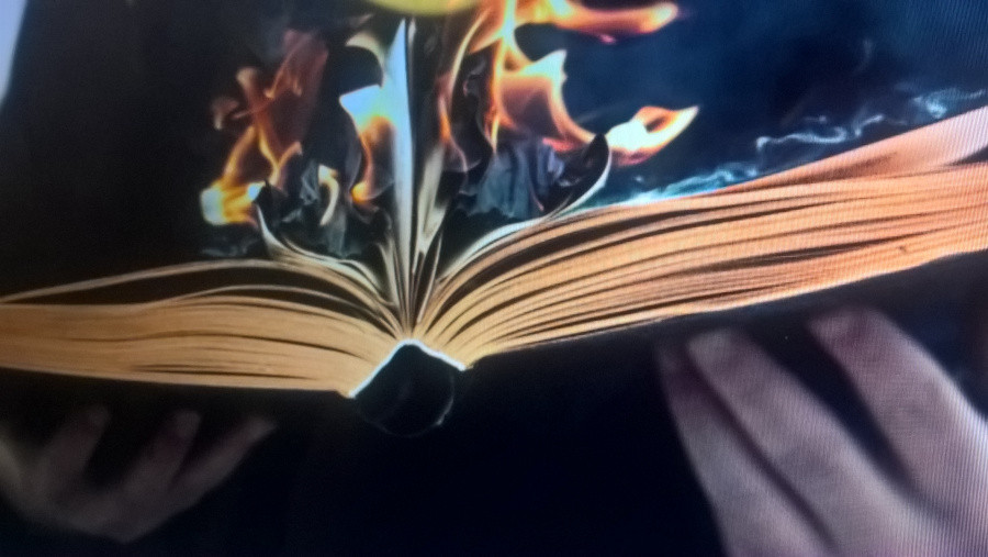A book with it's pages on fire