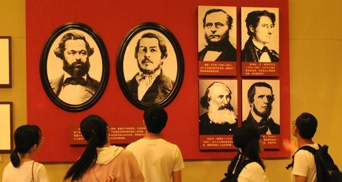 Visitors attend, The Power of Truth: An Exhibition Marking the Bicentenary of the Birth of Karl Marx at the National Museum of China. Photo: IC