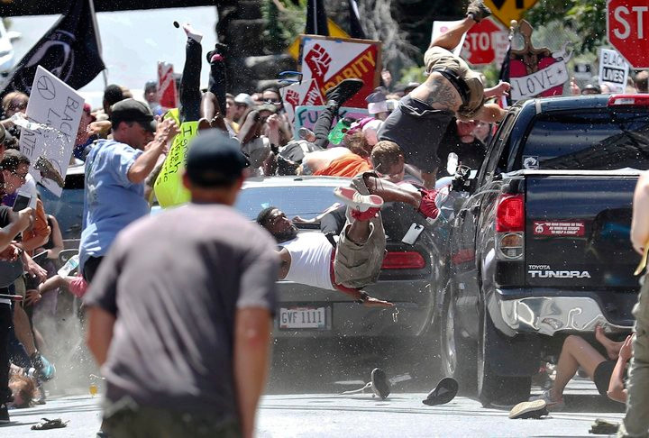 "James Fields Jr drives his car through protestors after the ""Unite the Right"" rally in Charlottesville, injuring at least 19 and killing Heather Heyes."