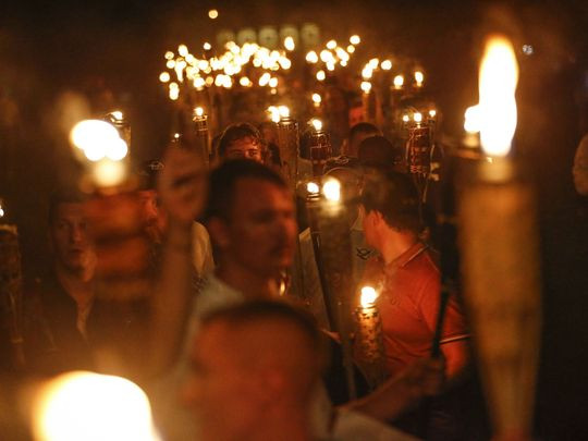 "Multiple white nationalist groups march with torches through the University of Virginia campus in Charlottesville, Va., on Friday, August 11, 2017. The chanted, ""Jews will not replace us.""  (Photo: Mykal McEldowney/IndyStar)"