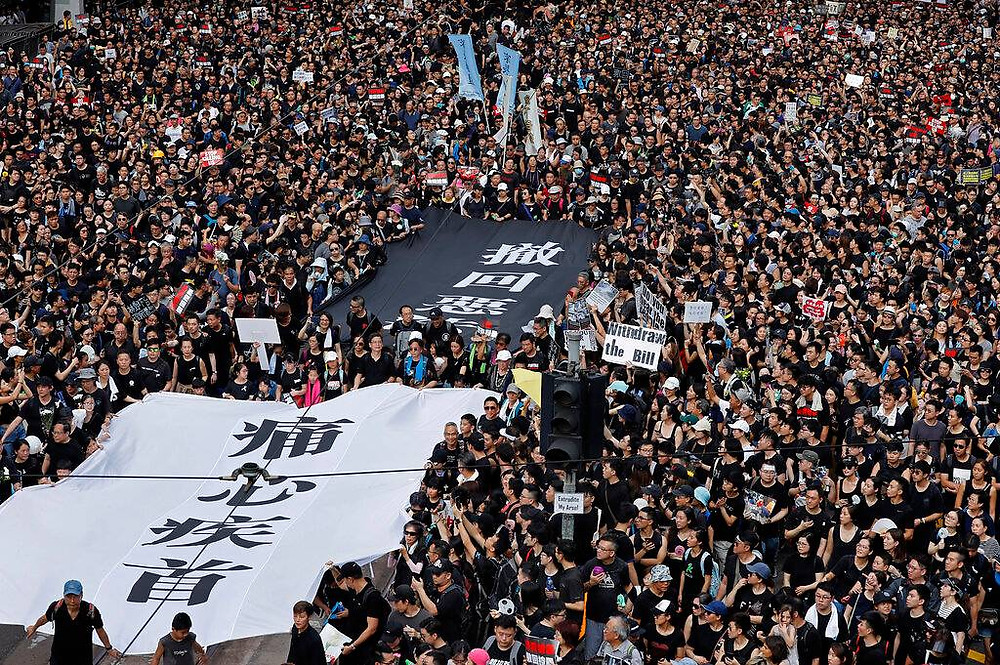 "Protesters carry a huge banner that reads ""Our hearts are torn to pieces. Withdraw the monstrous bill"" as they march on the streets against an extradition Bill in Hong Kong on Jun 16, 2019. (Photo: AP) Read more at https://www.channelnewsasia.com/news/asia/a-history-of-massive-hong-kong-protests-11633630"