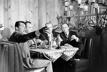 Dean Martin and Frank Sinatra dining