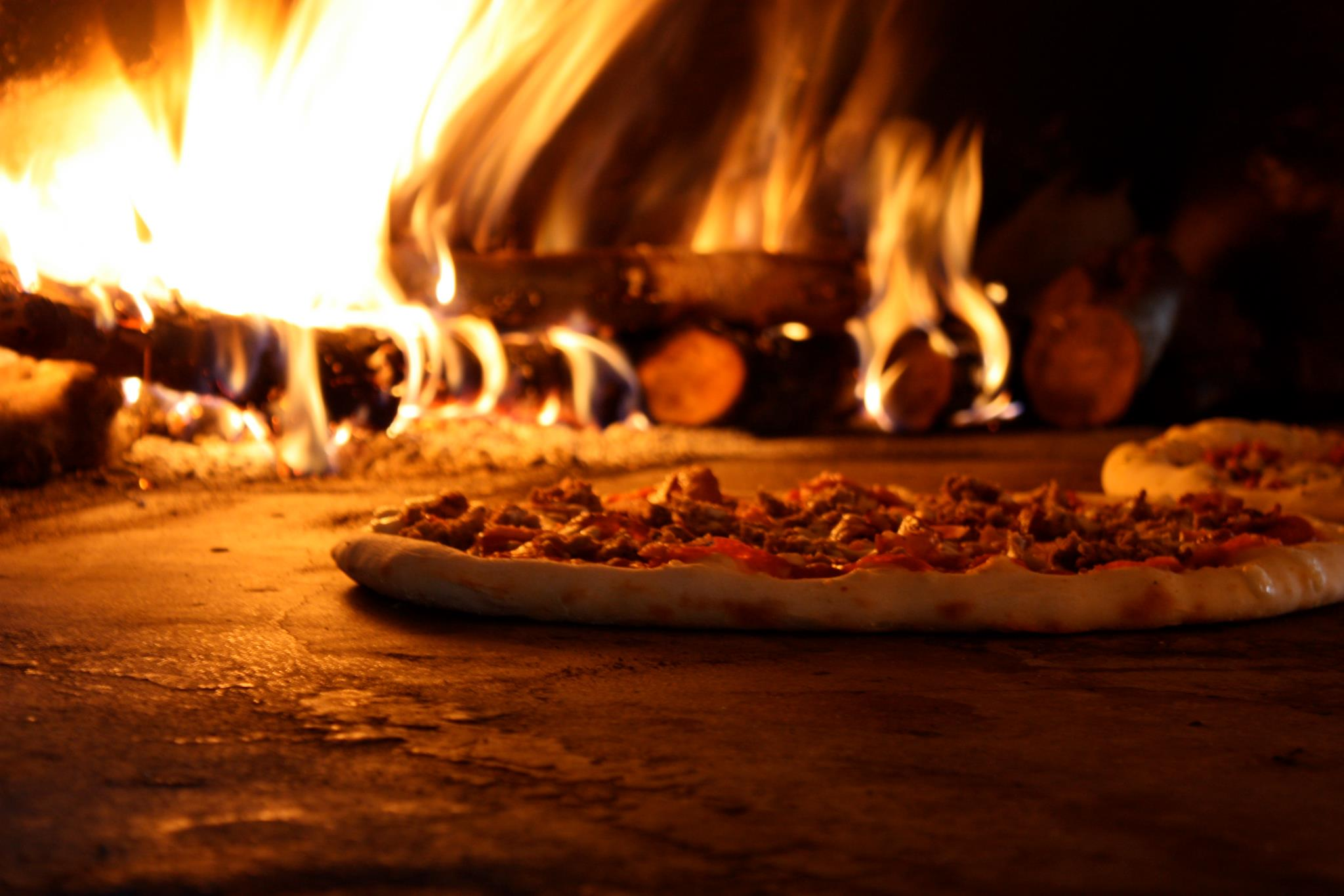 Freshly baked pizza wooden log fire