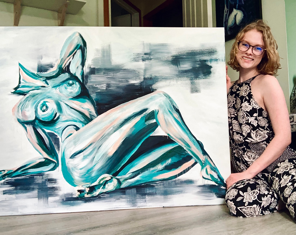 An artist posing with her painting of the female body.