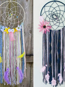 """2 - 10"""" metal hoops wrapped witih yarn, knotted web, faux flowers, yarns, ribbons and feathers."""