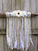 Found Birch branch with ribbons, yarns, feathers & faux flowers