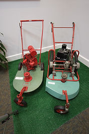 Prototype Kee Lawnmower on the left and manufactured Kee Mower on the right. Located in the Horticulture Room.