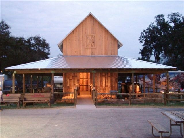 two story wooden barn with a wide roof overhang for storage