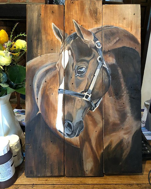 Horse on wooden pallets