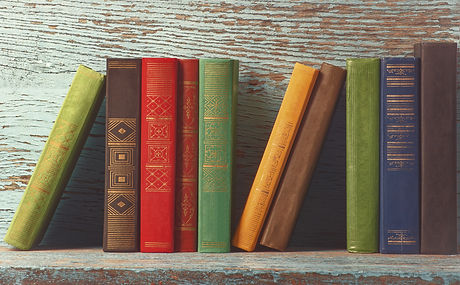 old books on the background of a wooden
