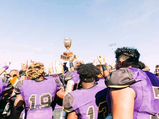Cowboy Football Retains Wilford Moore Trophy