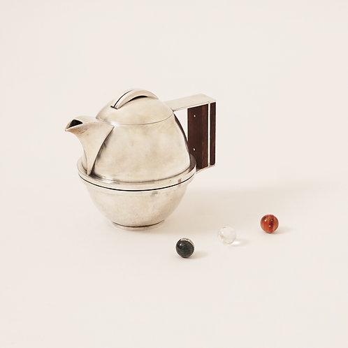 Jean Després, A Rare Tin and Madagascar Ebony Wood Tea-Pot, Circa 1930