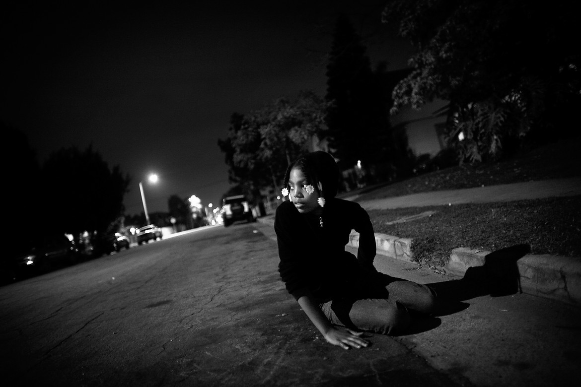 "India Franklin sits on the road next to the spot where her cousin, Jamiel ""Jas"" Shaw II, was gunned down. The slight but speedy running back for Los Angeles High School was recruited by Rutgers and Stanford before he was killed.  The 17-year-old was three doors from home when Pedro Espinoza, an 18th Street gang member and illegal immigrant, allegedly shot him to death. Jas' father, Jamiel Shaw Sr., heard the shots, ran out of the house and found his son lying on the sidewalk, bleeding to death."