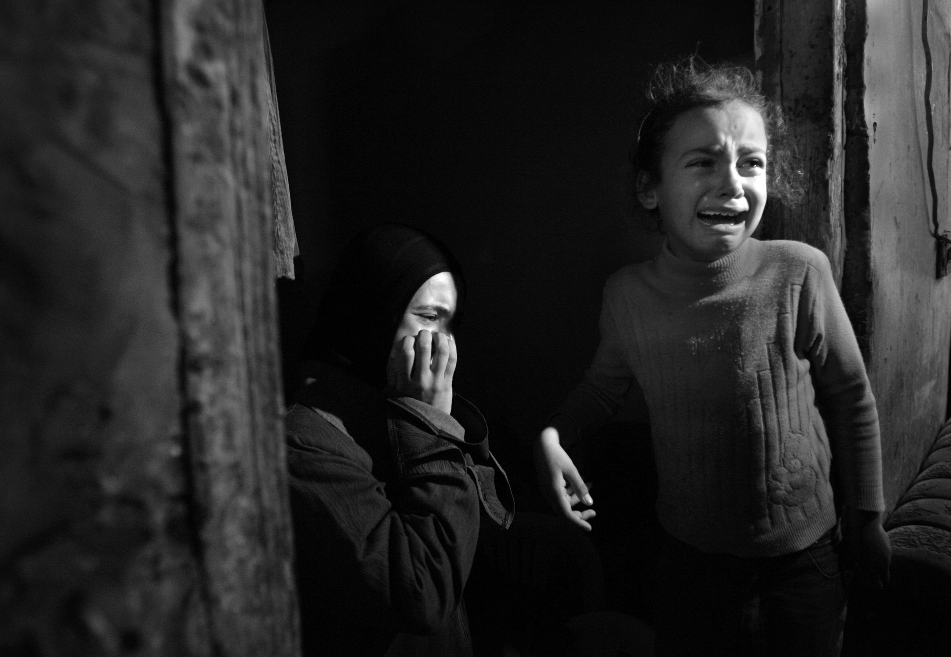 Mamdoh Abaid's sisters are consumed by grief as his body is brought into their small family home  during his funeral in Gaza.