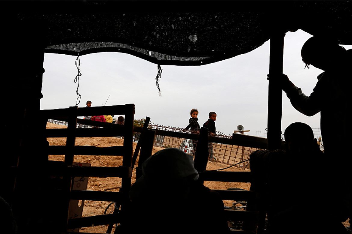 Bedouins wait for aid to arrive.