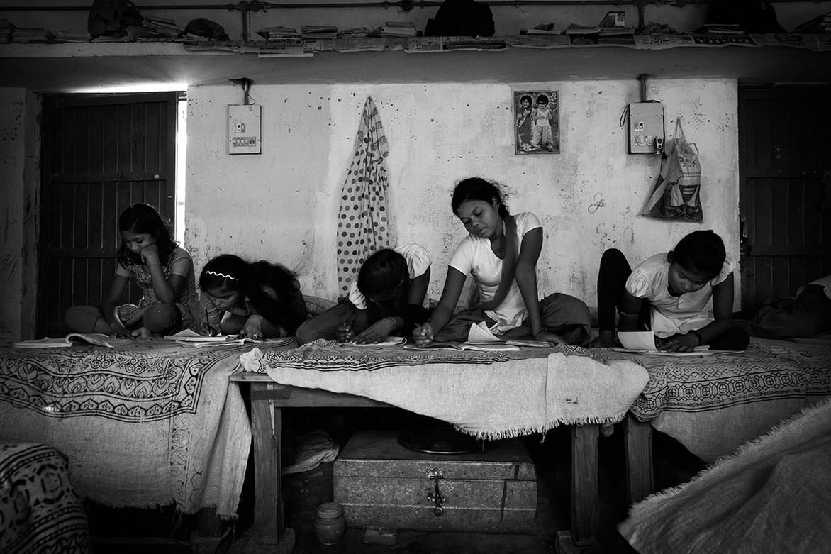 The girls work on homework. The aim of the school is to break the cycle of intergenerational prostitution by offering the girls a safe place to be educated.