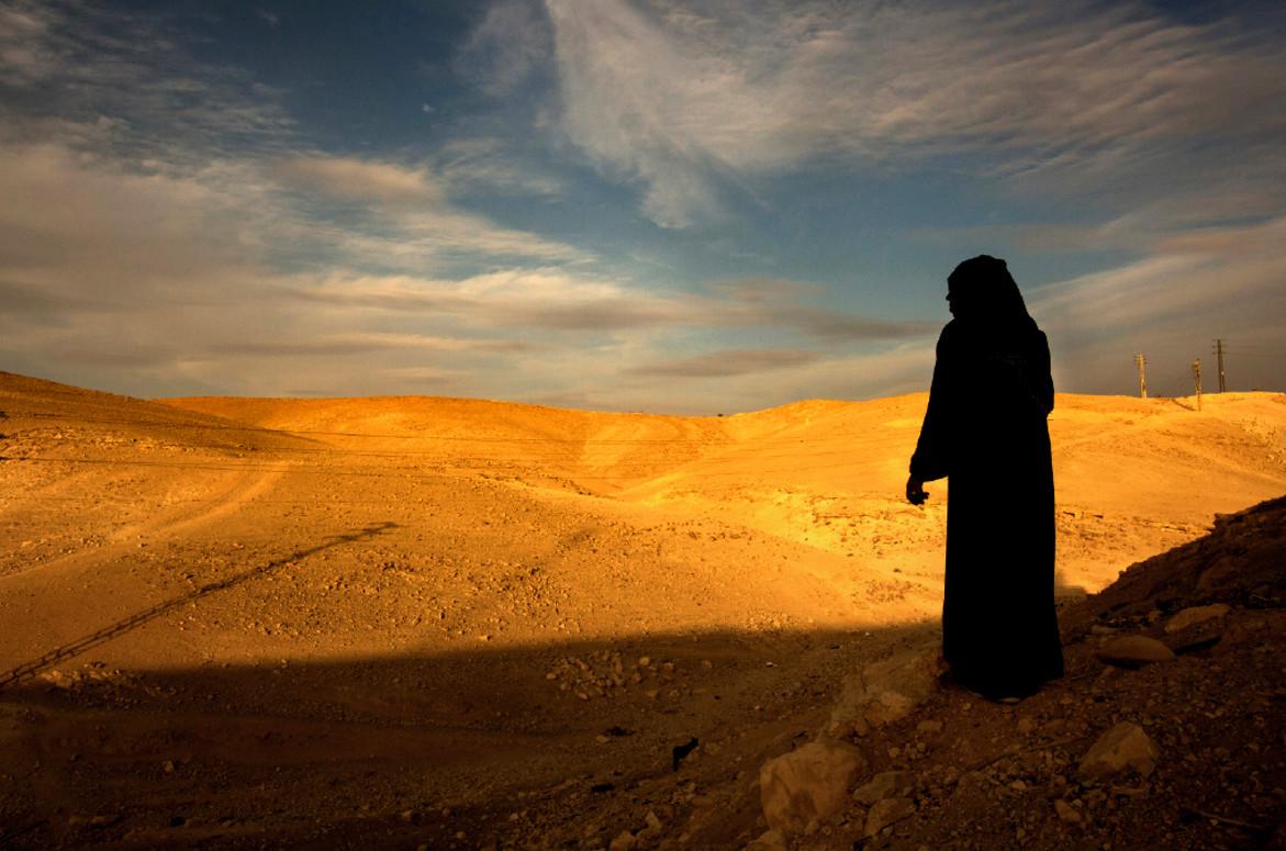 The morning sun colors the Judean desert a burnt orange.